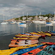 A rainbow of kayaks on Tuna Wharf in Rockport harbor.