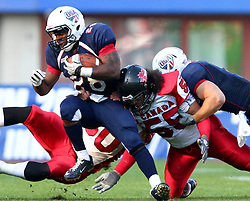 16.07.2011, Ernst Happel Stadion, Wien, AUT, American Football WM 2011, United States of America (USA) vs Canada (CAN), im Bild Da'Shawn Thomas (USA, #28, RB) gets stopped by Steve Faoro (Canada, #50, LB) and Peter Carrière (Canada, #55, LB)  // during the American Football World Championship 2011 game, USA vs Canada, at Ernst Happel Stadion, Wien, 2011-07-16, EXPA Pictures © 2011, PhotoCredit: EXPA/ T. Haumer