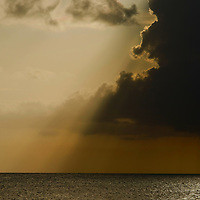 Sunset at Delaport west nassau behind s large thunder cloud