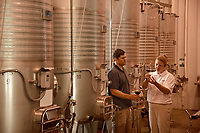 Surry County extension agent Joanna Radford (right) talks wine with Herrea Vineyards' Kevin Childers.
