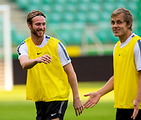29/07/14<br /> CELTIC TRAINING<br /> PEPSI ARENA - WARSAW<br /> All smiles from Celtic signing Jo Inge Berget (left) as he trains in Warsaw