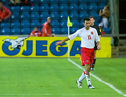 OSLO, NORWAY - Wednesday, September 5, 2001: Wales' Ryan Giggs throws away his captains armband after being sent off following two yellow cards during the FIFA World Cup 2002 Qualifying Group 5 match against Norway at the Ullevaal Stadion. (Pic by David Rawcliffe/Propaganda)