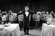 U.S. President George W. Bush takes a bow after leading the Marine Band in 'The Stars and Stripes Forever' during his final appearance at the White House Correspondents' Association dinner in Washington.