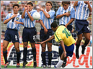Brazil's midfielder Rivaldo  kicks the ball over the Argentina's players during a friendly match in Porto Alegre, Brazil, on September 7 1999.(Alejandro PAGNI/PHOTOXPHOTO)