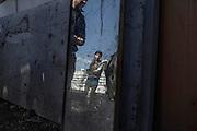 Un giovane rom all'interno del campo del quartiere periferico di Tor Sapienza, durante la visita di Matteo Salvni. Roma 24 Febbraio 2016. Christian Mantuano / OneShot