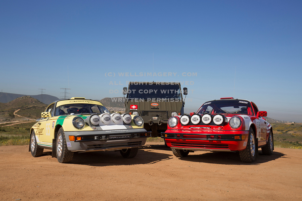 "Image of ""Desert Flyer"" and ""Red Sled"" Porsche 964s competing in the 2017 NORRA Mexican 1000 Rally with the Rothsport Racing Team, and the Scheel-Mann 1974 Steyr-Puch Pinzgauer support vehicle, Baja California Sur, Mexico"