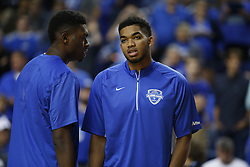 Kentucky Alum Karl-Anthony Towns, right, talks with teammate Kentucky Alum Dakari Johnson before the game. The Kentucky Alumni Men's Basketball team hosted the University of North Carolina Alumni in a charity game, Sunday, Sept. 13, 2015 at Rupp Arena in Lexington. <br /> <br /> Photo by Jonathan Palmer