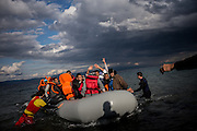A dingy trasporting about 40 migranst is arriving on the shores of Lesbos after crossing from Turkey