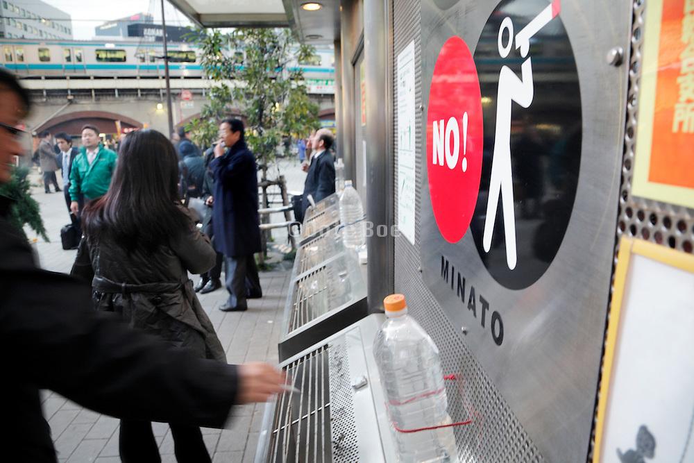 warning sign at a designated smoking spot in Tokyo Japan