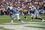 Los Angeles Chargers defensive end Melvin Ingram III (54) runs with the ball as he intercepts a third quarter pass in his own end zone during the NFL week 5 regular season football game against the Oakland Raiders on Sunday, Oct. 7, 2018 in Carson, Calif. The Chargers won the game 26-10. (©Paul Anthony Spinelli)