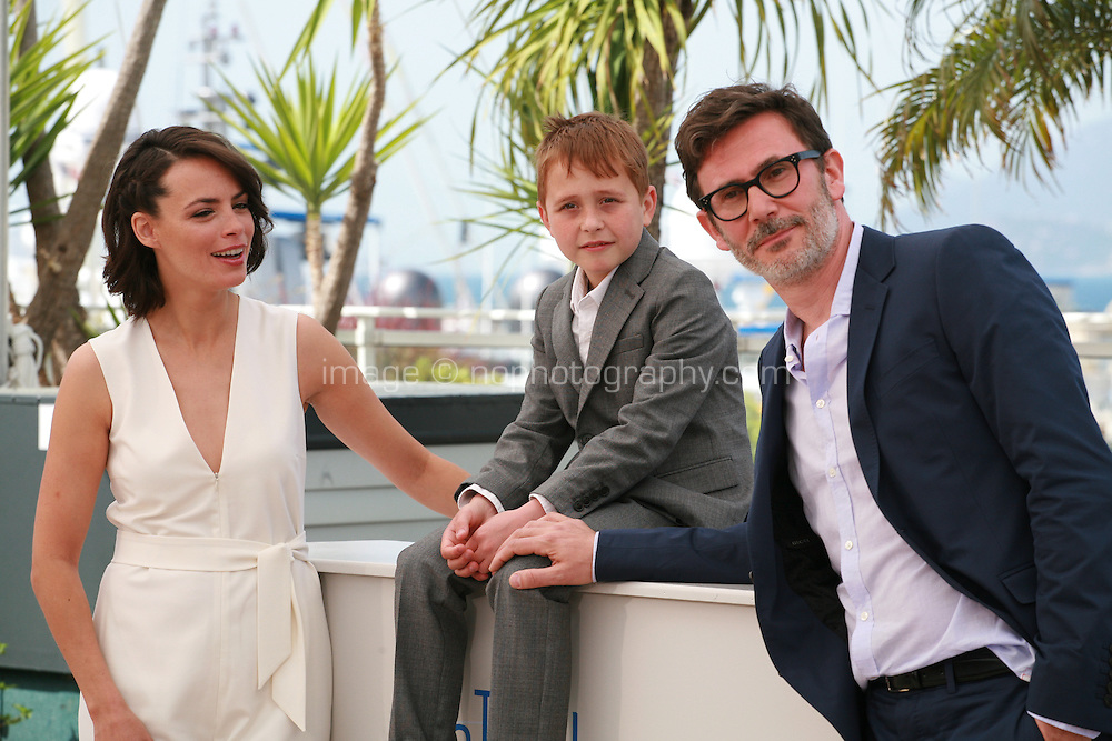 Bérénice Bejo, Abdul-Khalim Mamatsuiev and Michel Hazanavicius at the photo call for the film The Search at the 67th Cannes Film Festival, Wednesday 21st  May 2014, Cannes, France.