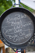 A menu is written in chalk in a dutch oven at Elk Fest in Jasper, Arkansas.