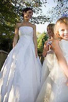 Mid-adult bride with two girl bridesmaids