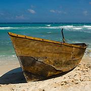 Cuban refugee boat on beach. Isla Mujeres, Quintana Roo. Mexico.