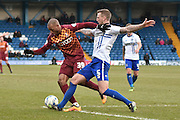 Bradford City Forward, Wes Thomas and Bury Defender, Peter Clarke during the Sky Bet League 1 match between Bury and Bradford City at the JD Stadium, Bury, England on 5 March 2016. Photo by Mark Pollitt.