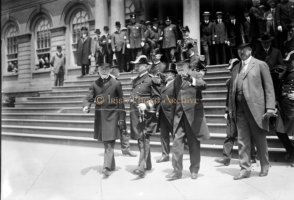 Unveiling of monument at entrance Central Park, New York to battleship Maine which exploded in Havana harbour in  Spanish-American War, 1898. Mayor Gaynor, Admiral  Badger and General Wilson on steps of City Hall, 19 May 1913.