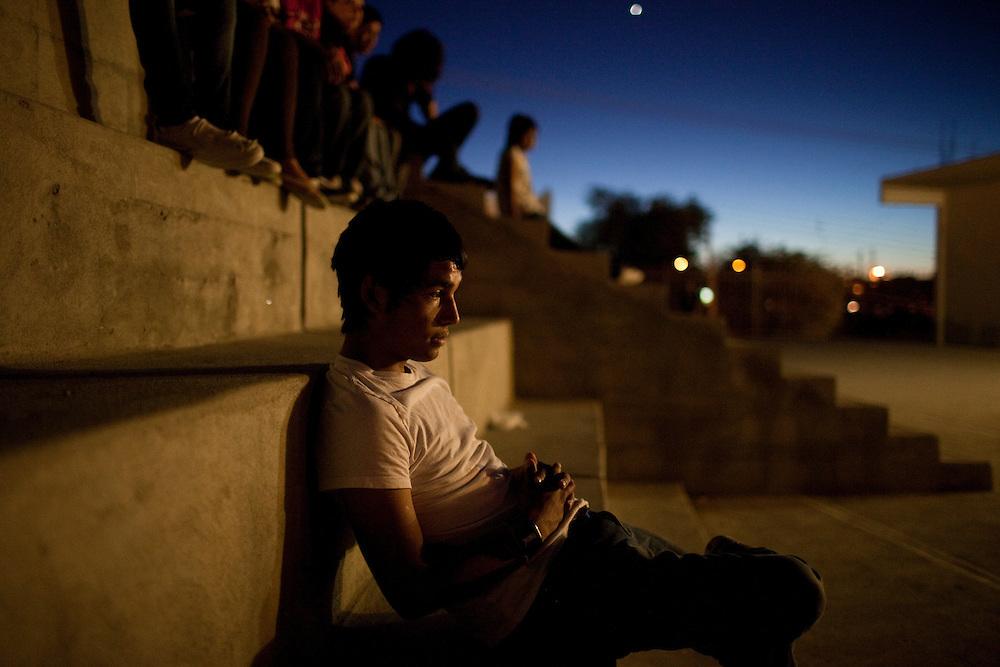 Juan Manuel Delgado, 18, watches his friends in Ciudad Juarez, Chihuahua Mexico on May 7, 2010. ..