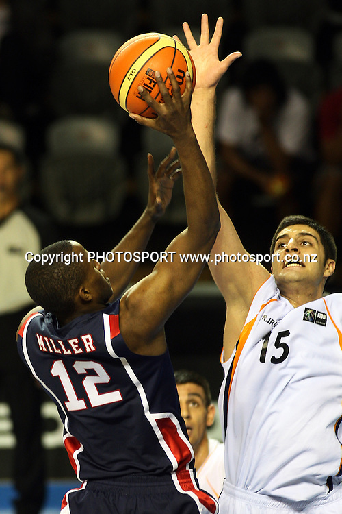 USA Forward Darius Miller shoots as Iranina Centre Farbod Farman attempts the block during the USA's 106-55 victory over Iran.<br />