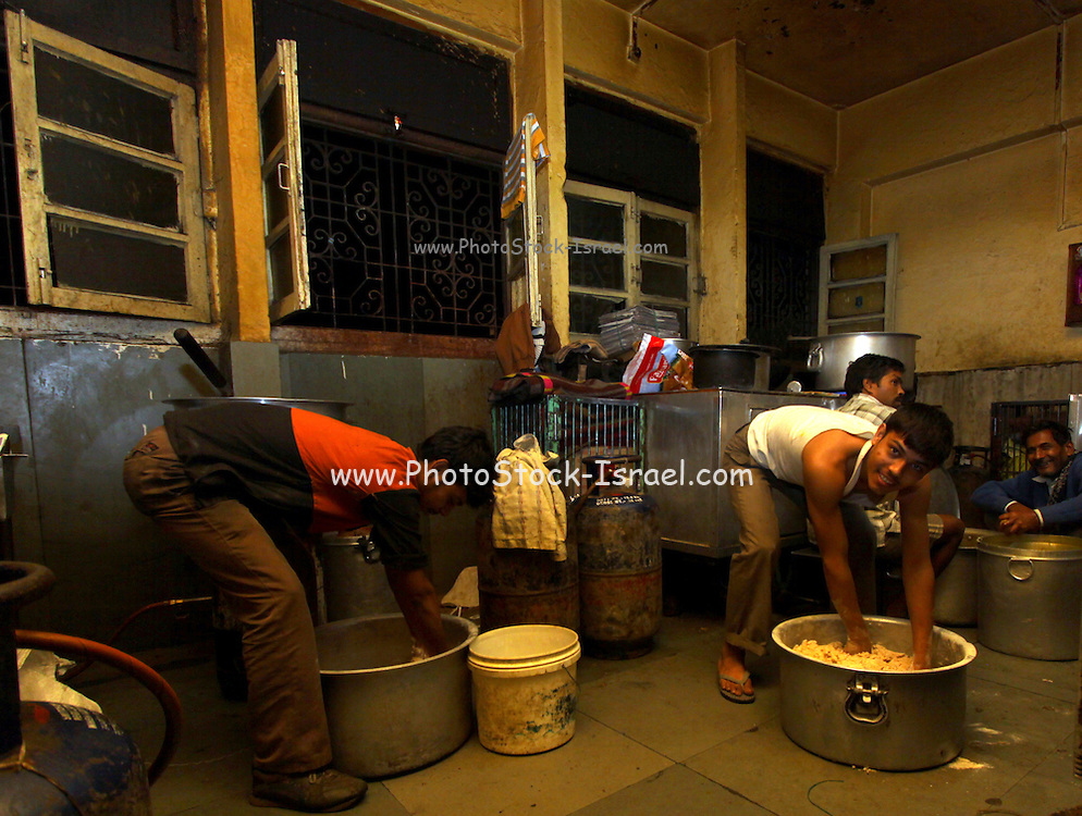 India, National Capital Territory of Delhi workers preparing food in a kitchen