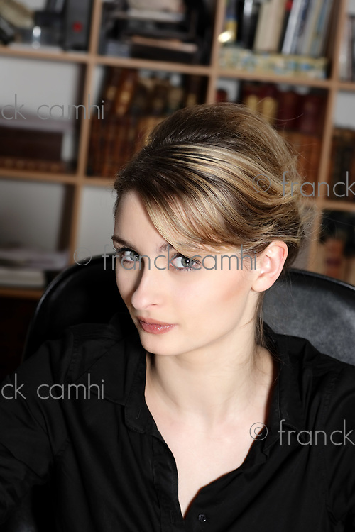 portrait of a cute and smiling businesswoman at the office desk