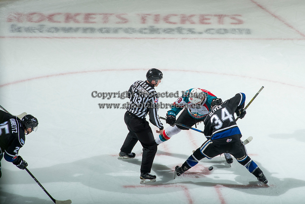 KELOWNA, CANADA - DECEMBER 30: Linesman Tim Plamondon drops the puck between Nolan Foote #29 of the Kelowna Rockets and Kaid Oliver #34 of the Victoria Royals on December 30, 2017 at Prospera Place in Kelowna, British Columbia, Canada.  (Photo by Marissa Baecker/Shoot the Breeze)  *** Local Caption ***