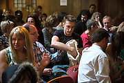 Attendees are giving an offer during The Sunday Assembly (today held inside Conway Hall in central London), an atheist service founded by British comedians Sanderson Jones and Pippa Evans in 2013, in London, England. The gathering is designed to bring together non-religious people who want a similar communal experience to a religious church. Satellite assemblies have been established in over 30 cities including New York, San Diego, and Dublin.