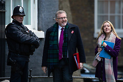 © Licensed to London News Pictures. 29/10/2018. London, UK. Secretary of State for Scotland David Mundell (centre) arriving in Downing Street for a cabinet meeting, ahead of the Chancellor of the Exchequer Philip Hammond's autumn budget statement this afternoon. Photo credit : Tom Nicholson/LNP