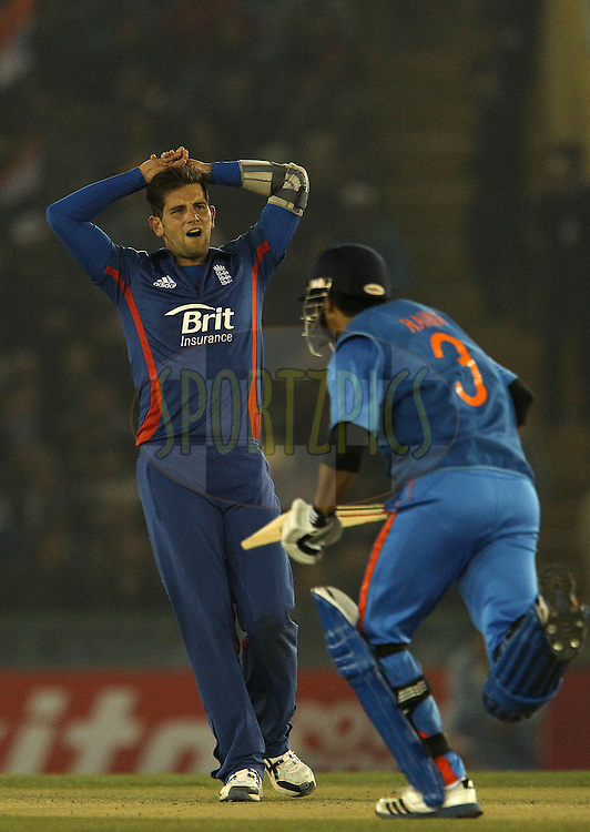 Jade Dernbach of England reacts after bowling during the 4th Airtel ODI Match between India and England held at the PCA Stadium, Mohal, India on the 23rd January 2013..Photo by Ron Gaunt/BCCI/SPORTZPICS ..Use of this image is subject to the terms and conditions as outlined by the BCCI. These terms can be found by following this link:..http://www.sportzpics.co.za/image/I0000SoRagM2cIEc