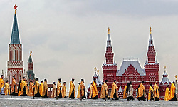 The Orthodox priests hold the ceremony of the celebrations of the Holiday of Cyrilius and Methodius (day of slavic culture) on the Red Square having Lenin's mausoleum, Kremlin tower and Historical museum in the backgroundon, Moscow, Monday, 24 May 2004. Saint Cyrilius and Methodius are the creators of the Cyrilic alphabet.