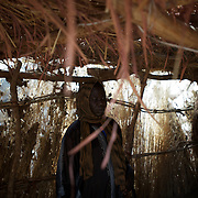 April 28, 2012 - Tabania, Nuba Mountains, South Kordofan, Sudan: A Nuba nurse assess the condition of civilian patients recovering from shrapnel injuries in a improvised field clinic near Tabania village in South Kordofan's Nuba Mountains in Sudan...Since the 6th of June 2011, the Sudan's Army Forces (SAF) initiated, under direct orders from President Bashir, an attack campaign against civil areas throughout the South Kordofan's province. Hundreds have been killed and many more injured...Local residents, of Nuba origin, have since lived in fear and the majority moved from their homes to caves in the nearby mountains. Others chose to find refuge in South Sudan, driven by the lack of food cause by the agriculture production halt due to the constant bombardments of rural areas. (Paulo Nunes dos Santos/Polaris)