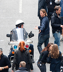 """Brad Pitt speaks to the police motorbike rider on the set of the movie """"World War Z"""" being shot in the city centre of Glasgow. The film, which is set in Philadelphia, is being shot in various parts of the Glasgow, transforming it to shoot the post apocalyptic zombie film..© pic : Michael Schofield."""