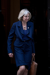 © Licensed to London News Pictures. 05/09/2012. LONDON, UK. Theresa May, the Home Secretary, is seen leaving Number 10 Downing Street in London today (05/09/12) after attending the first cabinet meeting after a cabinet reshuffle that took place yesterday (04/09/12).  Photo credit: Matt Cetti-Roberts/LNP