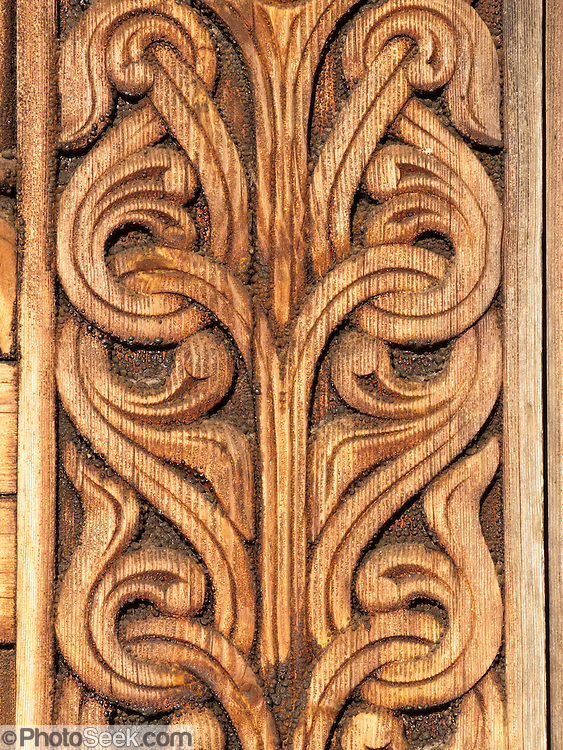 "Art pattern carved in wood. Heddal stave church is Norway's largest stave church. This triple nave stave church, which some call ""a Gothic cathedral in wood,"" was built in the early 13th century and restored in 1849-1851 and the 1950s. Heddal stavkirke is in Notodden municipality, Telemark County, Norway."