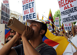 © licensed to London News Pictures. LONDON, UK.  27/06/11. A Free Tibet protester shouts through a rolled up piece of cardboard. A protest was held outside Downing Street  today (27 June2011). The protest was aimed at the Chinese Premier, Wen Jiabao, who was visiting British Prime Minister David Cameron. Pro China and Free Tibet protesters where present. today (27 June2011). Mandatory Credit Stephen Simpson/LNP