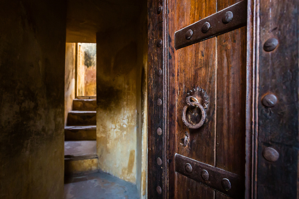 An open door reveals the narrow paths inside the Amber Palace