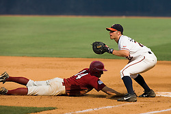 Lafayette Leopards OF James Conrad (14) beats the pick off tag at first.  The Virginia Cavaliers defeated the Lafayette Leopards 5-1 at Davenport Field in Charlottesville, VA.  The game, held on June 1, 2007 was the first of the NCAA World Series Regional.