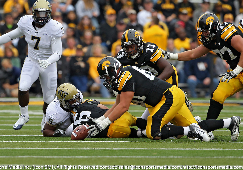September 17, 2011: Iowa Hawkeyes offensive linesman Matt Tobin (60) picks up a fumbled ball during the first half of the game between the Iowa Hawkeyes and the Pittsburgh Panthers at Kinnick Stadium in Iowa City, Iowa on Saturday, September 17, 2011. Iowa defeated Pittsburgh 31-27.