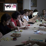Women playing bingo in Almaden de la Plata , Badajoz province, Extremadura region, Spain  . The WAY OF SAINT JAMES or CAMINO DE SANTIAGO following the Silver Way, between Seville and Astorga, SPAIN. Tradition says that the body and head of St. James, after his execution circa. 44 AD, was taken by boat from Jerusalem to Santiago de Compostela. The Cathedral built to keep the remains has long been regarded as important as Rome and Jerusalem in terms of Christian religious significance, a site worthy to be a pilgrimage destination for over a thousand years. In addition to people undertaking a religious pilgrimage, there are many travellers and hikers who nowadays walk the route for non-religious reasons: travel, sport, or simply the challenge of weeks of walking in a foreign land. In Spain there are many different paths to reach Santiago. The three main ones are the French, the Silver and the Coastal or Northern Way. The pilgrimage was named one of UNESCO's World Heritage Sites in 1993. When there is a Holy Compostellan Year (whenever July 25 falls on a Sunday; the next will be 2010) the Galician government's Xacobeo tourism campaign is unleashed once more. Last Compostellan year was 2004 and the number of pilgrims increased to almost 200.000 people.