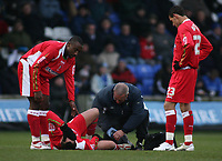 Photo: Paul Thomas.<br /> Macclesfield Town v Swindon Town. Coca Cola League 2. 23/12/2006.<br /> <br /> Swindon's Sofian Zaaboub (Ground) recieves treatment but is carried off injured.