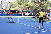 Serena Williams and Raphael Nadal play at the Nike Youth Tennis  Challenge held at The Nike -Built regulation Tennis Court  on West 23rd Street & Broadway in New York  City . ..Hundreds of tennis fans and youth form New York  Parks and Rec. Athlethes for Charity, and Mentoring USA are treating to tips and guidance from Tennis Pros Roger Federer, Rafael Nadal and Serena Williams...