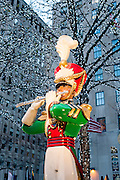 Christmas statue at Rockefeller Plaza with Christmas decorations and lights, New York City.
