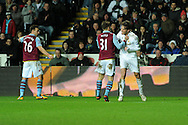 Chris Herd of Aston Villa gets to grips with Swansea's Michu as the pair exchange words. Barclays Premier league, Swansea city v Aston Villa at the Liberty Stadium in Swansea, South Wales on New Years Day, Tuesday 1st Jan 2013. pic by Andrew Orchard, Andrew Orchard sports photography,