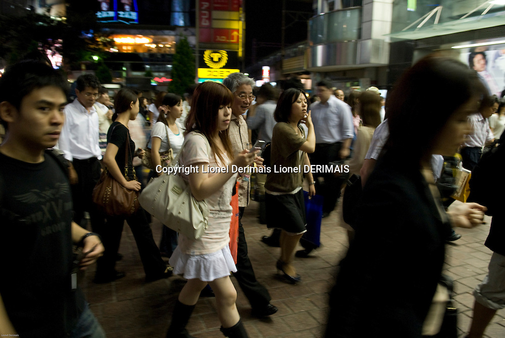 People rush to Shibuya station to catch their train home, Tokyo.