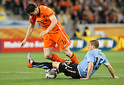 CAPE TOWN, SOUTH AFRICA- Tuesday 6 July 2010, Mark van Bommel gets tackled by Diego Perez during the semi final match between Uruguay and the Netherlands (Holland) held at the Cape Town Stadium in Green Point during the 2010 FIFA World Cup..Photo by Roger Sedres/Image SA