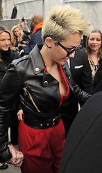 (UK RIGHTS ONLY) Miley Cyrus wearing a black leather bikers jacket, red suit leaving Rachel Zoe Fall 2013 fashion show during Mercedes-Benz Fashion Week at The Studio, Lincoln Center in New York City., USA. 13/02/2013<br />BYLINE MUST READ : EAGLEPRESS/GOTCHA IMAGES<br /><br />Copyright by © Gotcha Images Ltd. All rights reserved.<br />Usage of this image is conditional upon the acceptance <br />of Gotcha Images Ltd, terms and conditions available at<br />www.gotchaimages.com
