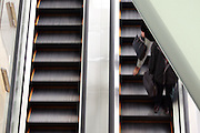 two moving escalators one going up other going down