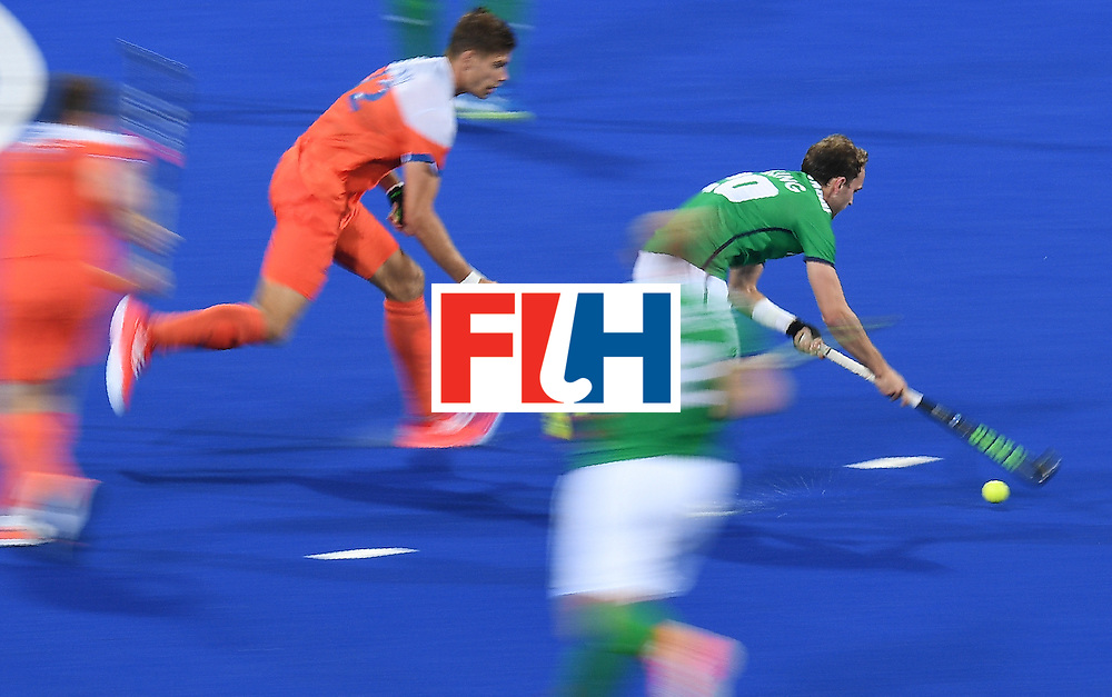 Ireland's Michael Darling controls the ball during the men's field hockey Netherlands vs Ireland match of the Rio 2016 Olympics Games at the Olympic Hockey Centre in Rio de Janeiro on August, 7 2016. / AFP / MANAN VATSYAYANA        (Photo credit should read MANAN VATSYAYANA/AFP/Getty Images)