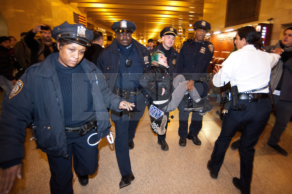 © licensed to London News Pictures. New York City, New York, USA. 3/01/12. Arrests take place during protests in Grand Central Station take place in Manhattan against the recently passed National Defence Authorisation Act (NDAA), which protesters are concerned introduced indefinite detention powers to be used against those suspected of terrorism. Photo credit: Jules Mattsson/LNP