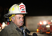07 September 2010: Brookline Fire Chief Larry Mcconnell talks with reporters about the fire that broke out at Atomic Fireworks early in the morning. Mcconnnell states there was minimal damage to the structure. Witnesses say they saw two individuals running from the building just prior to the fire taking place. Credit: David Welker / TurfImages.com