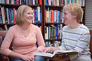 19090A day in the life of Elizabeth Wolfe.. ..Elizabeth Wolfe working at HSLS in Grover Center, talking to Brooke Hallowell